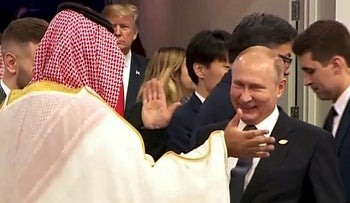 In this still image obtained from an Argentina G20 video, Russia's President Vladimir Putin (C) and Saudi Arabia's Crown Prince Mohammed bin Salman greet each other at the G20 Leaders' Summit in Buenos Aires, on November 30, 2018, as US President Donald Trump enter the room