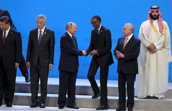 World leader line up for a 'family photo' during the G20 Leaders' Summit, on November 30, 2018 in Buenos Aires