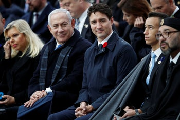 File photo: Israeli PM Netanyahu, Canadian PM Trudeau and Moroccan King Mohammed VI attend ceremonies at the Arc de Triomphe, Paris, November 11, 2018.