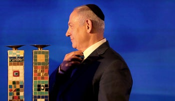 Israeli Prime Minister Benjamin Netanyahu attends a Likud Party gathering marking the first day of the eight-day Jewish holiday of Hanukkah, in Ramat Gan, Israel December 2, 2018.