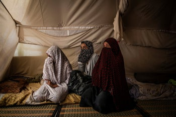 An Egyptian woman and two daughters in their tent, at Roj Camp for the families of Islamic State members in Kurdish-controlled northern Syria, June 23, 2018.