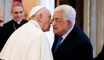 Pope Francis speaks with Palestinian President Mahmoud Abbas at the end of a private audience at the Vatican, on December 3, 2018.