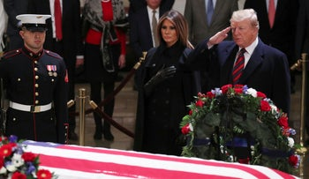 U.S. President Donald Trump salutes and first lady Melania Trump pays respects at the casket of former President George H.W. Bush, Capitol Hill, December 3, 2018.
