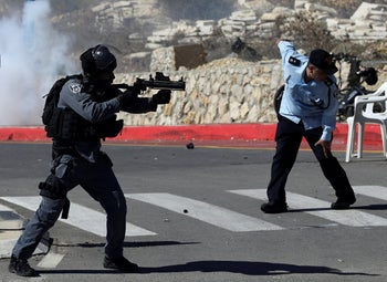 Israeli police firing tear gas canisters to disperse Druze protesters outside a polling station in Majdal Shams, October 30, 2018