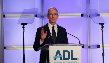 """Apple CEO Tim Cook addressing attendees at the ADL's """"Never is Now"""" anti-Semitism summit in New York, December 3, 2018."""