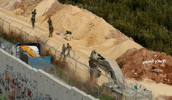 A photo released by Hezbollah Central Military Media, shows Israeli military digger work on the border, near Kafr Kila, Lebanon, December,  4, 2018.