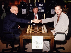 Boris Gulko, left, and Nigel Short shaking hands as Donald Trump looks on before the quarterfinal of the World Chess Championship in Trump Tower, New York, 1994.