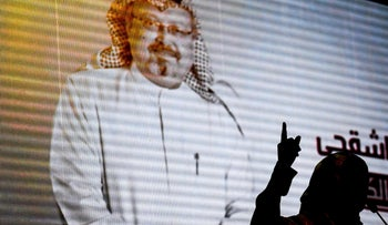 Nobel Peace Prize laureate Yemeni Tawakkol Karman stands in front of a digital image of Jamal Khashoggi as she speaks during a commemoration event in Istanbul on Sunday, November 11, 2018.