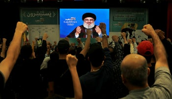 Hezbollah leader Hassan Nasrallah gives a speech via a video link at a rally marking Hezbollah Martyr's Day, in Beirut, Lebanon, November 10, 2018.