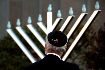 Rabbi Jeffrey Myers watches the installation of a menorah outside the Tree of Life Synagogue before holding a celebration on the first night of Hanukkah, December 2, 2018, in Pittsburgh.