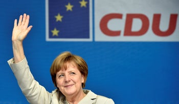 German chancellor Angela Merkel waving to supporters at a Christian Democratic Union election party, December 4, 2018.