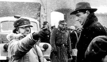 "Director Steven Spielberg on the set of ""Schindler's List"" in Poland with the film's star, Liam Neeson, in 1993."