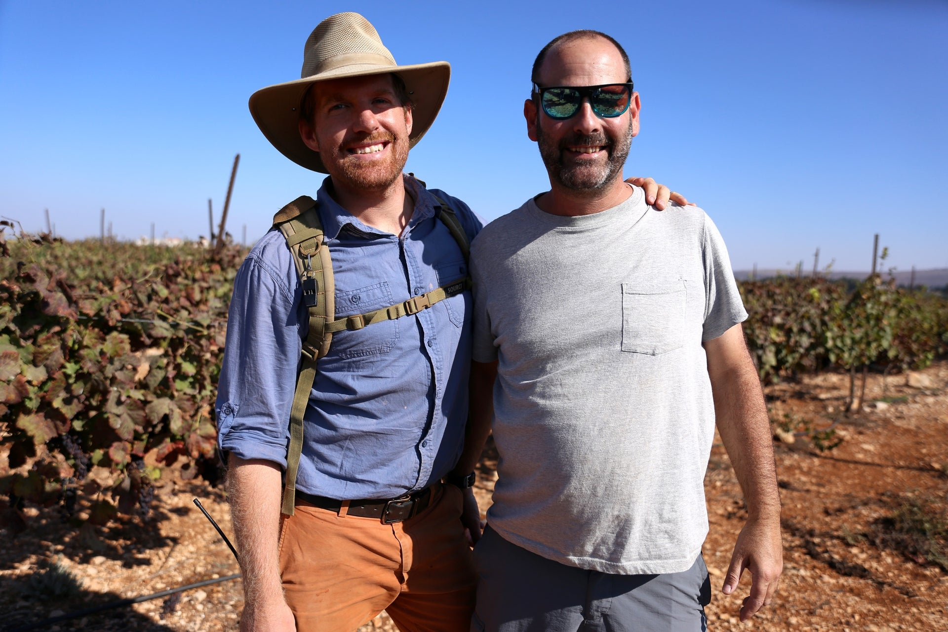 """Nir Lavie, owner of Tura Winery, and Caleb Waller, son of Hayovel founder Tommy Waller. Asked if the winery was profitable, Lavie responds: """"Baruch Hashem"""""""