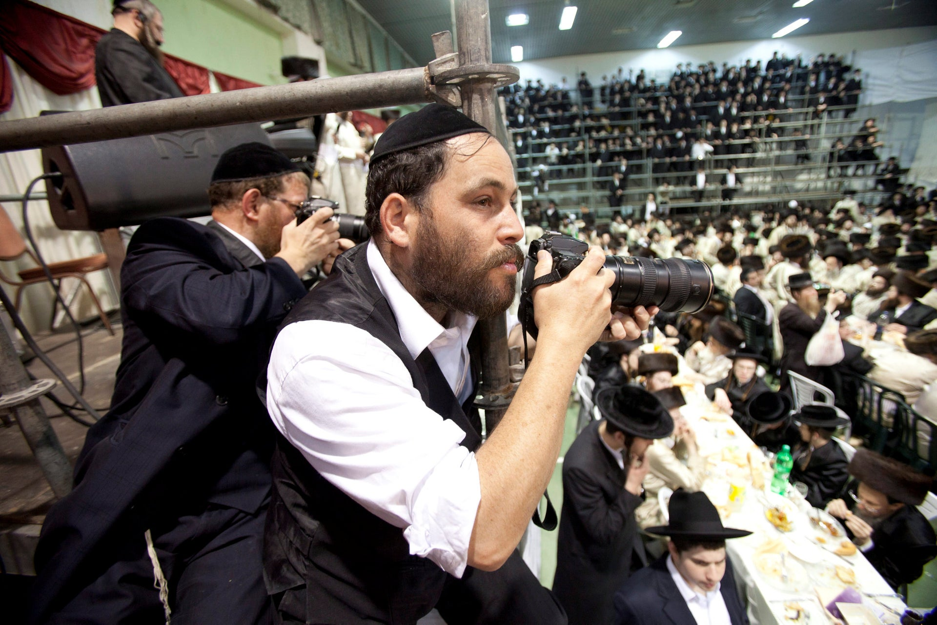 Shuki Lerer, the country's official admor photographer, at a Hasidic wedding.