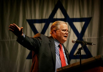 American Evangelist John Hagee addresses a crowd of his followers and Israeli supporters at a rally at the Jerusalem convention center, Sunday, April 6, 2008.