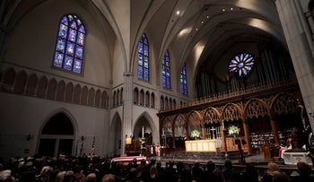Attendees sit during a funeral service for former U.S. President George H.W. Bush at St. Martin's Episcopal Church in Houston, Texas, December 6, 2018