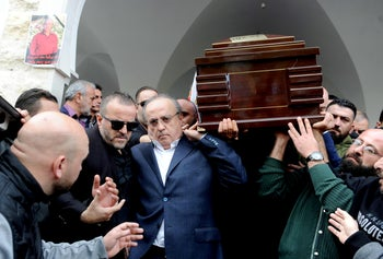 Relatives carry the coffin of Mohammed Abu Diab, a bodyguard of the former Lebanese minister Wiam Wahhab, during his funeral in the village of al-Jahiliya, in Mount Lebanon, December 2, 2018