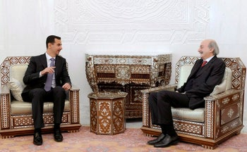 FILE PHOTO: Syrian President Bashar Assad with Lebanese Druze leader Walid Jumblatt in Damascus, Syria, March 31, 2010