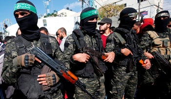 Members of Hamas' military wing attend the funeral of seven Palestinians who were killed during a botched Israeli army raid, Khan Younis, Gaza, November 12, 2018.