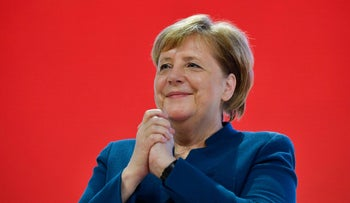 German Chancellor Angela Merkel cheers after delivering her speech at a party congress, Hamburg, December 7, 2018