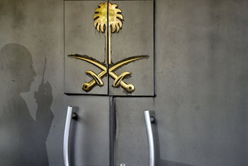 The shadow of a security official is seen on the door of the Saudi Arabian consulate, Istanbul, November 1, 2018.