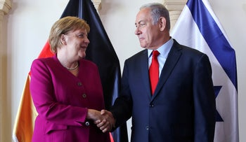 File photo:  Prime Minister Benjamin Netanyahu (R) and German Chancellor Angela Merkel shake hands as they pose for photographers between meetings in Jerusalem October 4, 2018.