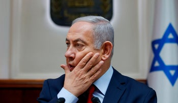 Israeli Prime Minister Benjamin Netanyahu attends the weekly cabinet meeting at the Prime Minister's office in Jerusalem on December 9, 2018.