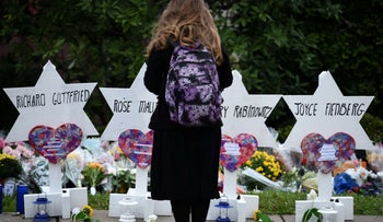 File photo: A woman stands at a memorial outside the Tree of Life synagogue after a shooting there left 11 people dead in the Squirrel Hill neighborhood of Pittsburgh, October 29, 2018.
