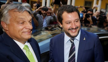 Italy's Interior Minister Matteo Salvini, left, meets with Hungary's Prime Minister Viktor Orban, in Milan, Italy, Tuesday, Aug. 28, 2018.