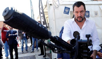 Italian Deputy Prime Minister and Interior Minister Matteo Salvini stands next to a sniper rifle during an event celebrating the state police SWAT team in Rome, Italy, October 10, 2018.