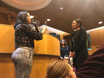 Alexandria Ocasio-Cortez (right) at a candle-lighting ceremony in Queens, New York, December 9, 2018.