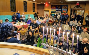 Hanukkah candle-lighting at the Jackson Heights Jewish Center, Queens, New York, December 9, 2018.