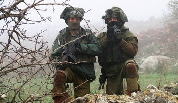 FILE PHOTO: Israeli soldiers guard near the border with Lebanon, December 5, 2018