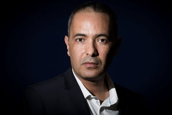 Algerian writer and journalist Kamel Daoud poses in Paris on April 14, 2016 after receiving the Jean-Luc Lagardere prize for journalist of the year.