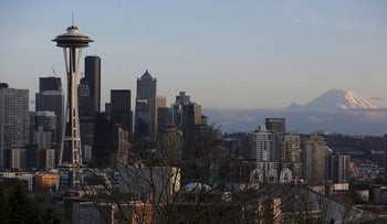 The Space Needle and Mount Rainier are seen on the skyline of Seattle, Washington, U.S. February 11, 2017