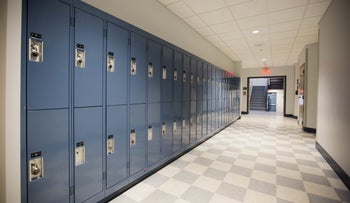 File photo: Lockers line a hallway inside a Catholic high school in the United States.