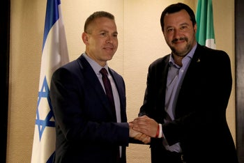 Italy's Matteo Salvini shaking hands with Israeli Public Security Minister Gilad Erdan during a news conference in Jerusalem, December 11, 2018.