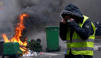 A protester wearing a yellow vest during a national day of protest, Paris, December 8, 2018.