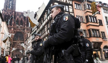 French police officers patrol next to Notre-Dame cathedral of Strasbourg following a shooting in the city of Strasbourg, eastern France, Wednesday, Dec. 12, 2018
