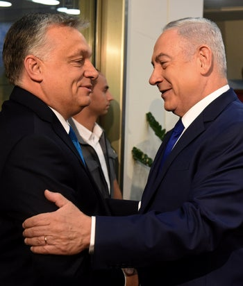 Hungarian Prime Minister Viktor Orban (L) is greeted by Israeli Prime Minister Benjamin Netanyahu (R) on his arrival to the prime minister's office in Jerusalem, Israel, July 19, 2018.