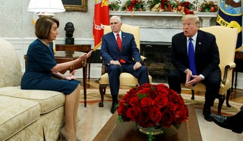 Vice President Mike Pence, center, looks on as House Minority Leader Rep. Nancy Pelosi and President Donald Trump argue during a meeting in the Oval Office, Dec. 11, 2018.