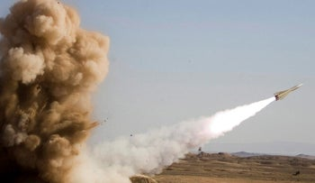 Photo purporting to show the launching of a Shahin missile outside the city of Semnan about 140 miles east of Tehran, Nov. 18.