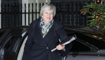 British Prime Minister Theresa May arrives for Prime Minister's Questions, in London, December 12, 2018.