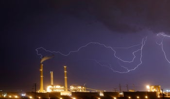 Lightning strikes over a power plant belonging to Israel Electric Company in Ashdod.