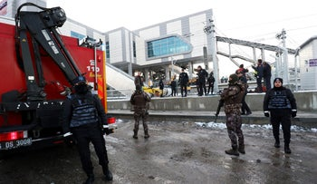 Turkish police stand guard near the scene of a high speed train crash in Ankara, Turkey December 13, 2018