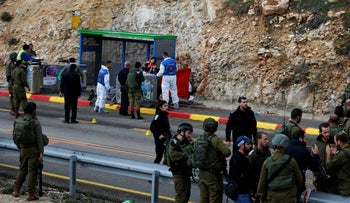 Israeli forces and medics are seen at the scene of a shooting attack near Ramallah in the Israeli-occupied West Bank December 13, 2018.