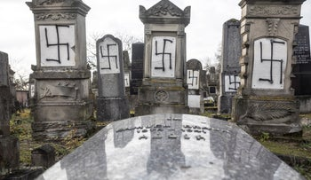 Jewish tombstones are desecrated with swastikas in the Herrlisheim Jewish cemetery, north of Strasbourg, eastern France, Thursday, Dec. 13, 2018.