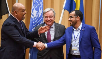 Yemen's foreign minister Khaled al-Yamani, left, and the head rebel negotiator Mohammed Abdelsalam shake hands under the eyes of UN Secretary General Antonio Guterres during peace consultations taking place in Sweden, on December 13, 2018