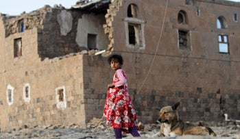 A girl walks near her house destroyed in an air strike carried out by the Saudi-led coalition in Faj Attan village, Sanaa, Yemen December 13, 2018.