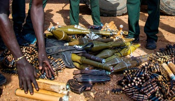 File photo: Rebel troops of the Sudan People's Liberation Army in Opposition (SPLA-IO) unload their weapons at their military site in Juba, South Sudan, 2016.